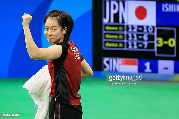 Kasumi Ishikawa of Japan celebrates the win in a match against Feng Tianwei of Singapore during the Women's Team Bronze Medal match on Day 11 of the...
