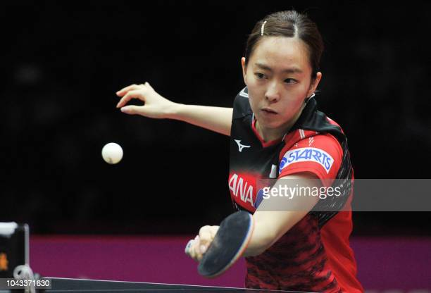Kasumi Ishikawa of Japan plays a shot during her women's singles third place match against Cheng Iching of Taiwan at the ITTF Women's World Cup table...