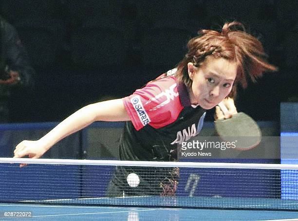 Kasumi Ishikawa of Japan plays during her firstround singles match of the World Tour Grand Finals table tennis tournament against South Korean Suh...