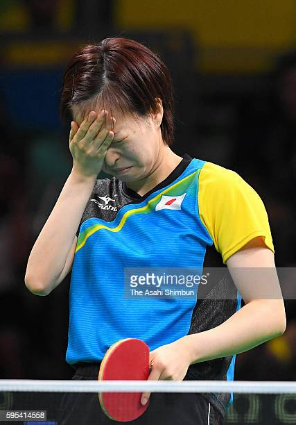 Kasumi Ishikawa of Japan reacts after a point against Han Ying of Germany in the Women's Team Semifinal between Japan and Germany on Day 9 of the Rio...
