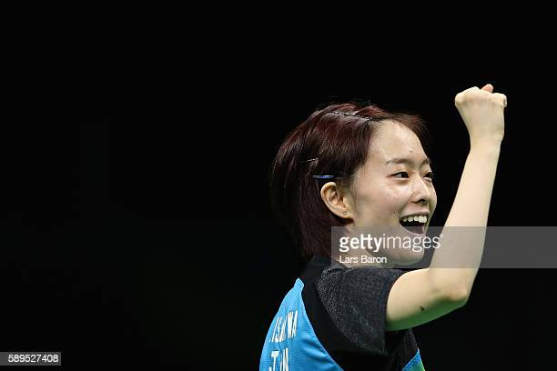 Kasumi Ishikawa of Japan reacts against Xiaona Shan of Germany during the Women's Team Semifinal 2 on Day 9 of the Rio 2016 Olympic Games at...