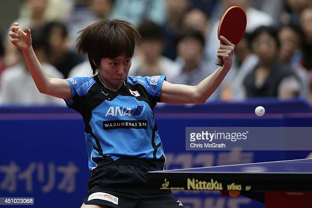 Kasumi Ishikawa of Japan returns a shot against Feng Tianwei of Singapore during the Women's Singles Final on day three of 2014 ITTF World Tour Japan...