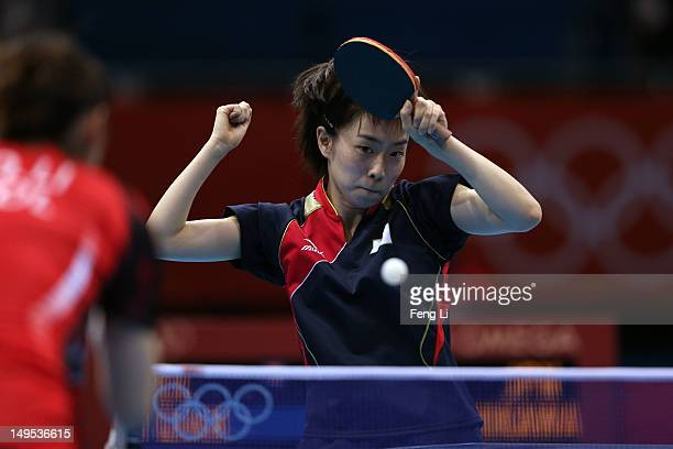 Kasumi Ishikawa of Japan returns the ball during her Women's Singles Table Tennis fourth round match against Qian Li of Poland on Day 3 of the London...