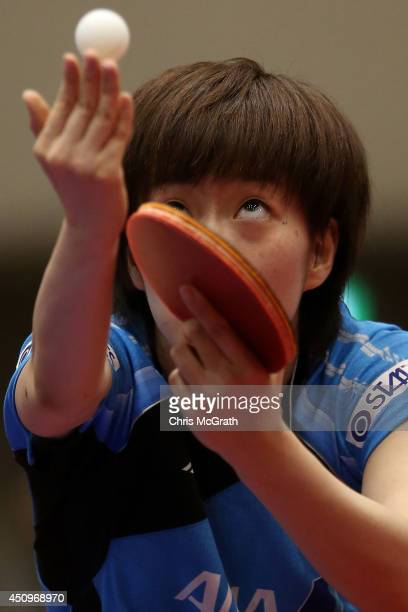 Kasumi Ishikawa of Japan serves against Yu Fu of Portugal during their Women's Singles match on day two of 2014 ITTF World Tour Japan Open at...