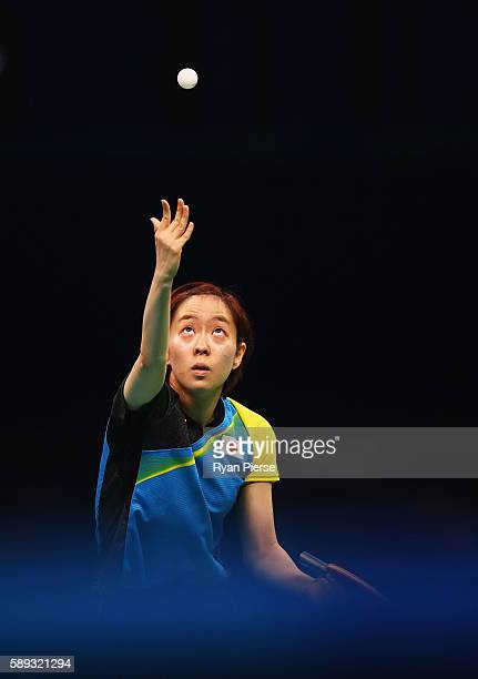 Kasumi Ishikawa of Japan serves during the Table Tennis Women's Team Round Quarter Final between Japan and Austria during Day 8 of the Rio 2016...