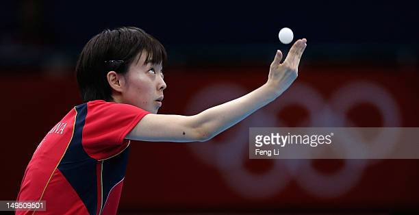 Kasumi Ishikawa of Japan serves in her Women's Singles Table Tennis third round match against Li Qiangbing of Austria on Day 2 of the London 2012...