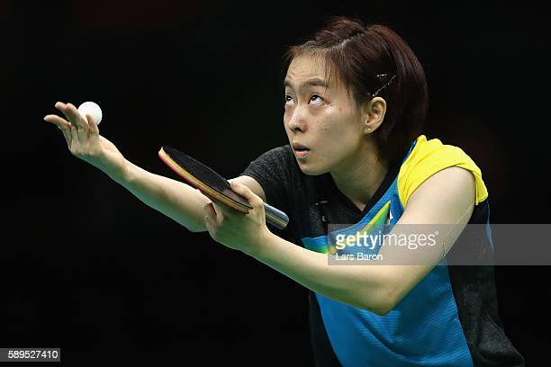Kasumi Ishikawa of Japan serves to Xiaona Shan of Germany during the Women's Team Semifinal 2 on Day 9 of the Rio 2016 Olympic Games at Riocentro...