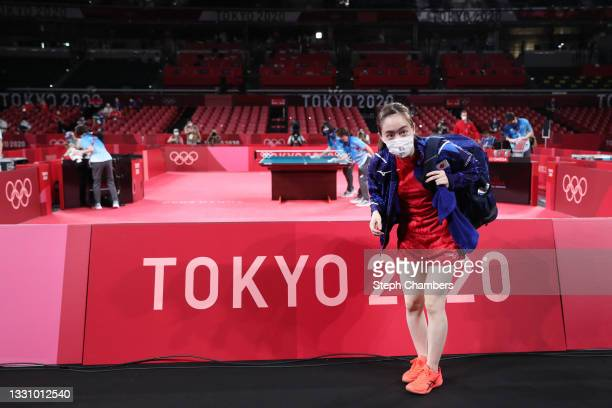 Kasumi Ishikawa of Team Japan bows after losing her Women's Singles Quarterfinals table tennis match on day five of the Tokyo 2020 Olympic Games at...
