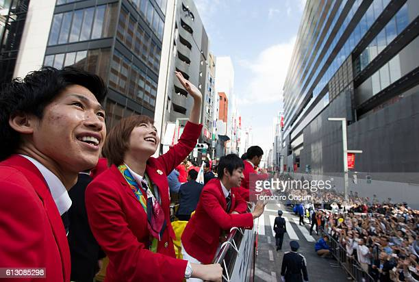 Kasumi Ishikawa second from right waves from the top of a double decker bus during the Rio Olympics 2016 Japanese medalist parade in the ginza...