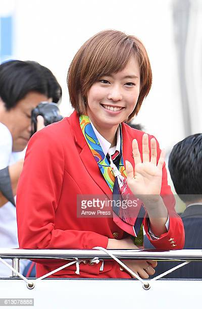 Kasumi Ishikawa waves on the top of a double decker bus during the Rio Olympic Paralympic 2016 Japanese medalist parade in the ginza district on...