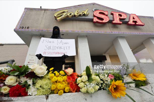 Kat Bagger shows her support for the Asian community as she stands in front of Gold Spa, one of three locations where deadly shootings happened...