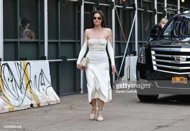Kat Collings is seen wearing a white Jacquemus dress outside the Khaite show during New York Fashion Week S/S 22 on September 12, 2021 in New York...