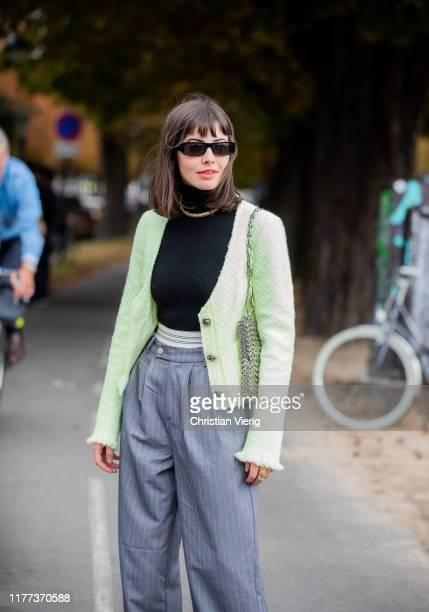Kat Collings seen wearing grey striped pants, neon jacket outside Y/Project during Paris Fashion Week Womenswear Spring Summer 2020 on September 26,...
