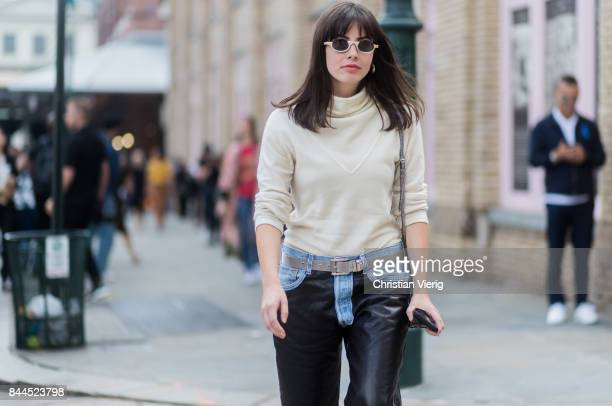 Kat Collings wearing two tone denim jeans leather pants seen in the streets of Manhattan outside Jason Wu during New York Fashion Week on September 8...