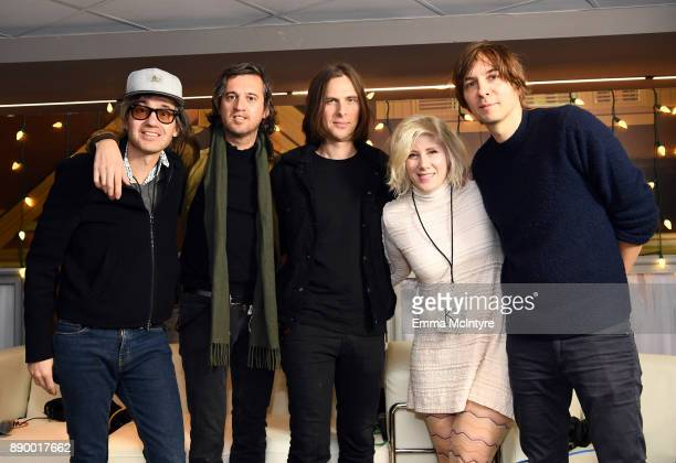 Kat Corbett poses backstage with Laurent Brancowitz, Christian Mazzalai Deck d'Arcy, Thomas Mars of Phoenix backstage during KROQ Almost Acoustic...