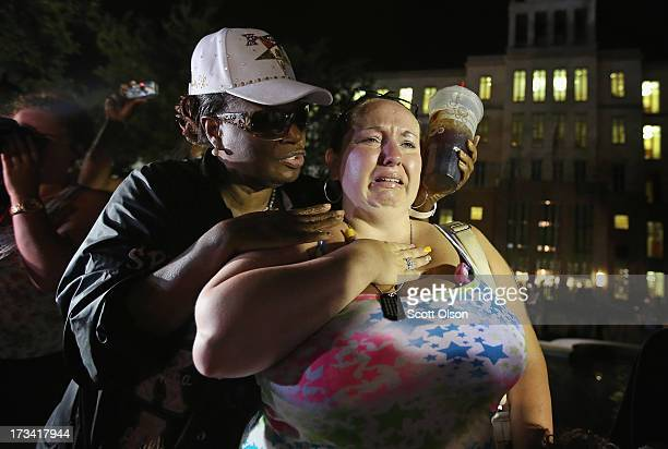 Kat Crowe and Melinda O'Neal comfort each other in front of the Seminole County Criminal Justice Center after learning George Zimmerman had been...