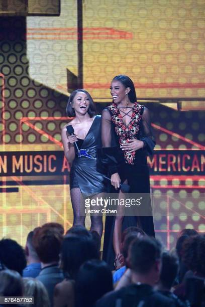 Kat Graham and Kelly Rowland speak onstage during the 2017 American Music Awards at Microsoft Theater on November 19 2017 in Los Angeles California
