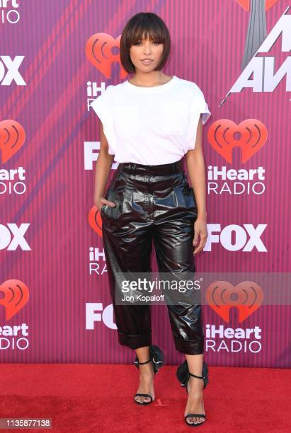 Kat Graham arrives at the 2019 iHeartRadio Music Awards which broadcasted live on FOX at Microsoft Theater on March 14 2019 in Los Angeles California