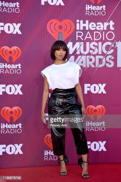 Kat Graham attends the 2019 iHeartRadio Music Awards which broadcasted live on FOX at Microsoft Theater on March 14 2019 in Los Angeles California