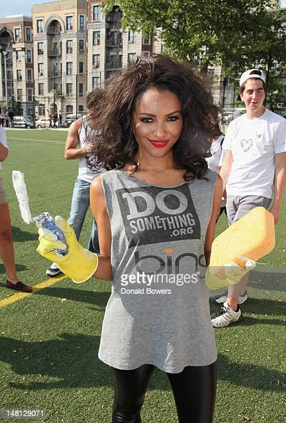Kat Graham helps restore CITYarts Mosiac Peace Wall during Bing and DoSomethingorg's celebration of The Bing Summer of Doing at Jacob H Schiff...