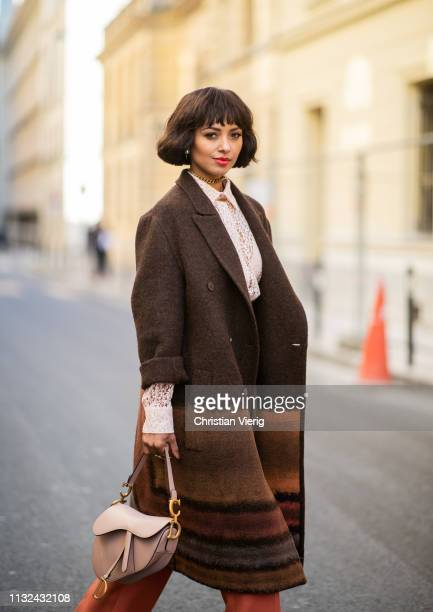 Kat Graham is seen wearing brown coat pink saddle bag outside Dior during Paris Fashion Week Womenswear Fall/Winter 2019/2020 on February 26 2019 in...