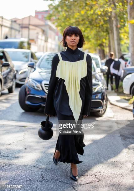 Kat Graham seen wearing black dress outside the Marni show during Milan Fashion Week Spring/Summer 2020 on September 20, 2019 in Milan, Italy.