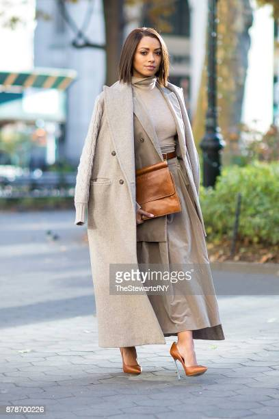 Kat Graham seen wearing Max Mara with a Dries Van Noten handbag in Madison Square Park on November 24 2017 in New York City