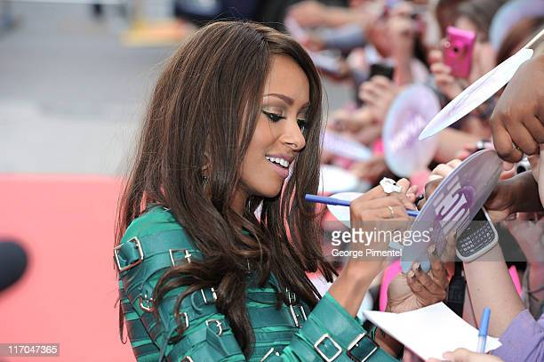 Kat Graham signs autographs on the red carpet at the 22nd Annual MuchMusic Video Awards at the MuchMusic HQ on June 19 2011 in Toronto Canada