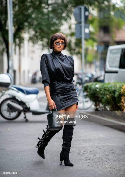 Kat Graham wearing black dress black boots and bucket bag Alessandra Rich and Giuseppe Zanotti is seen during Milan Fashion Week Spring/Summer 2019...