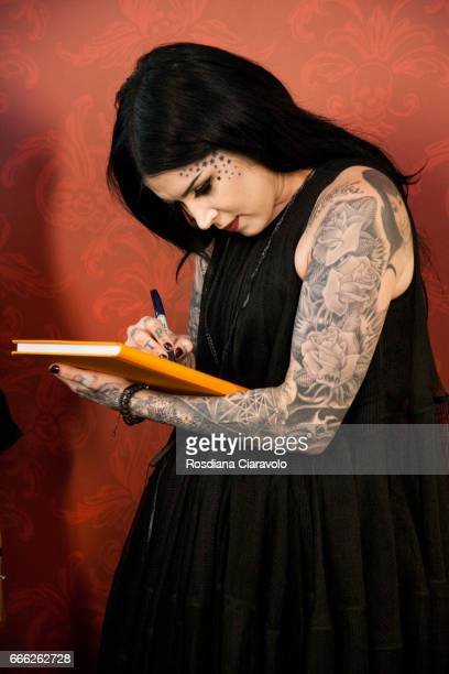 Kat Von D signs a book as she meets her fans at at Sephora Cso Vittorio Emanuele Milan on April 8 2017 in Milan Italy