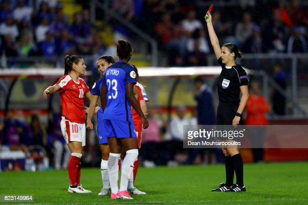 Katalin Kulcsár oh Hungary shows the red card to Eve Perissetof France during the Group C match between Switzerland and France during the UEFA...