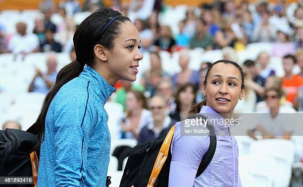 Katarina JohnsonThompson and Jessica EnnisHill of Great Britain walk out into the stadium prior to competing in the Womens Long Jump during day two...