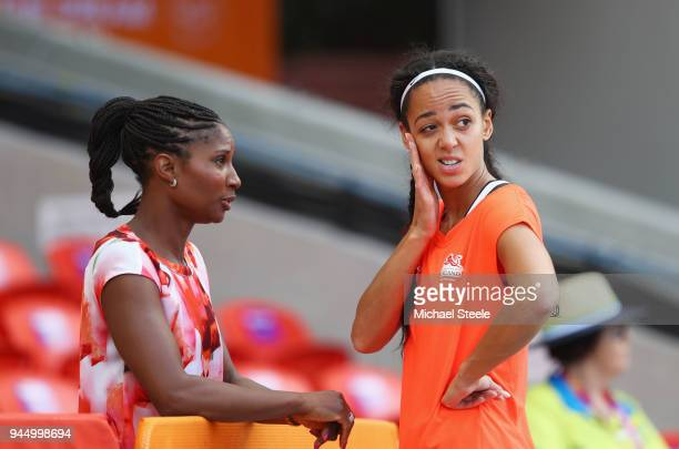 Katarina JohnsonThompson of England in discussion with former heptathlete Denise Lewis after the Women's Heptathlon High Jump during athletics on day...