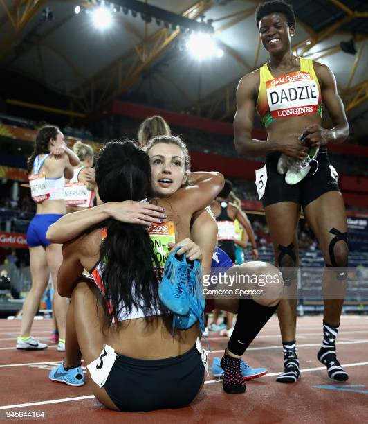 Katarina JohnsonThompson of England is embraced by Katy Sealy of Belize after the Women's Heptathlon 800 metres during athletics on day nine of the...