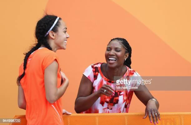 Katarina JohnsonThompson of England jokes with former heptathlete Denise Lewis after the Women's Heptathlon High Jump during athletics on day eight...