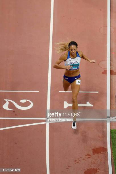 Katarina JohnsonThompson of Great Britain crosses the finish line in the 800 Metres on her way to winning gold in the Women's Heptathlon during day...
