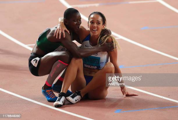 Katarina JohnsonThompson of Great Britain is congratulated by Odile Ahouanwanou of Benin after the 800 Metres and winning gold in the Women's...