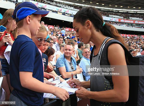 Katarina JohnsonThompson of Great Britain signs autographs for fans during day two of the Muller Anniversary Games at The Stadium Queen Elizabeth...