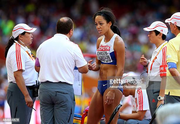 Katarina JohnsonThompson of Great Britain speaks with officials while competing in the Women's Heptathlon Long Jump during day two of the 15th IAAF...