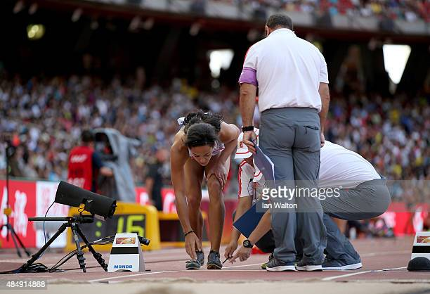 Katarina Johnson-Thompson of Great Britain speaks with officials while competing in the Women's Heptathlon Long Jump during day two of the 15th IAAF...
