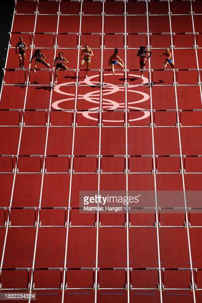 Katarina Johnson-Thompson of Team Great Britain leads the field in the Women's Heptathlon 100m Hurdles heats on day twelve of the Tokyo 2020 Olympic...