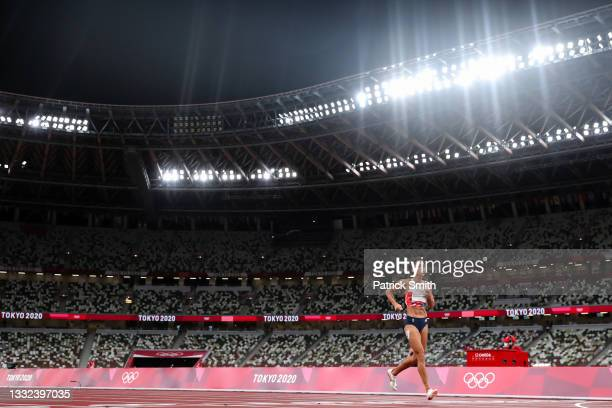 Katarina Johnson-Thompson of Team Great Britain limps towards the finish line in the Women's Heptathlon 200m on day twelve of the Tokyo 2020 Olympic...
