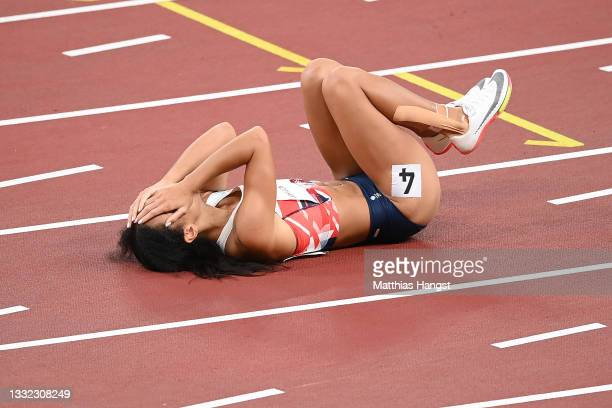 Katarina Johnson-Thompson of Team Great Britain reacts as she lies injured after the Women's Heptathlon 200m heats on day twelve of the Tokyo 2020...
