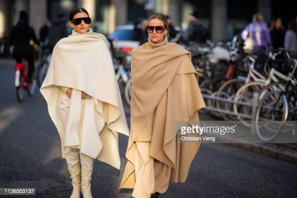 Katarina Petrovic and Celine Aagaard wearing oversized beige scarf is seen outside Mykke Hofmann during the Copenhagen Fashion Week Autumn/Winter...