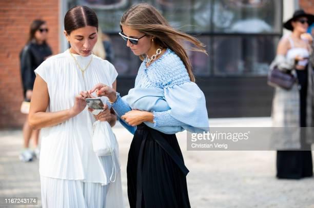 Katarina Petrovic and Nina Sandbech seen outside Munthe during Copenhagen Fashion Week Spring/Summer 2020 on August 07, 2019 in Copenhagen, Denmark.