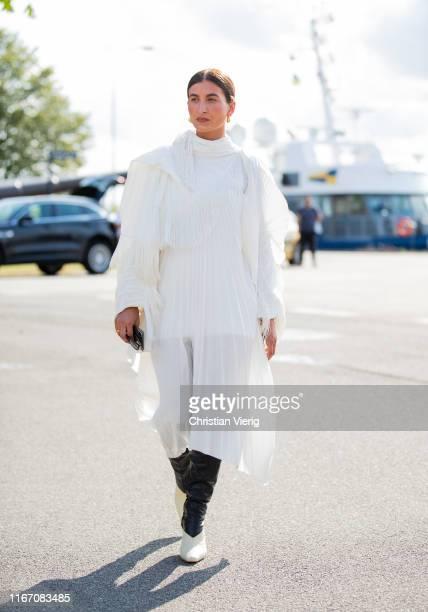 Katarina Petrovic seen wearing white pleated dress outside Stine Goya during Copenhagen Fashion Week Spring/Summer 2020 on August 08, 2019 in...
