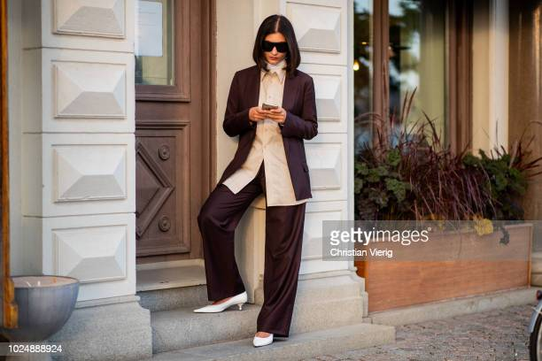 Katarina Petrovic wearing bordeaux suit is seen during Stockholm Runway SS19 on August 28 2018 in Stockholm Sweden