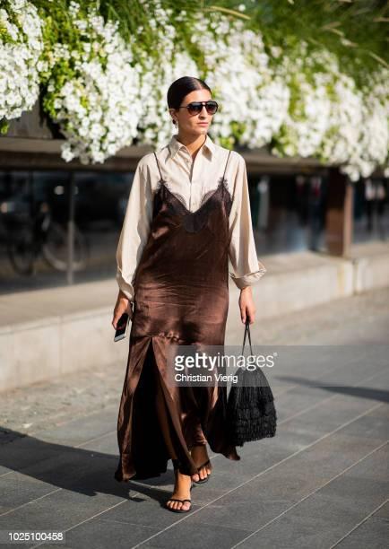 Katarina Petrovic wearing brown velvet dress is seen during Stockholm Runway SS19 on August 29 2018 in Stockholm Sweden