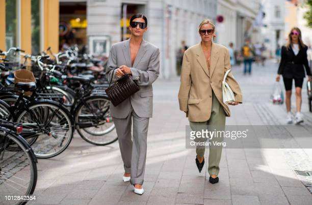 Katarina Petrovic wearing grey suit white pointed heels black bag and Celine Aagaard wearing beige oversized blazer olive green pants pointed flats...