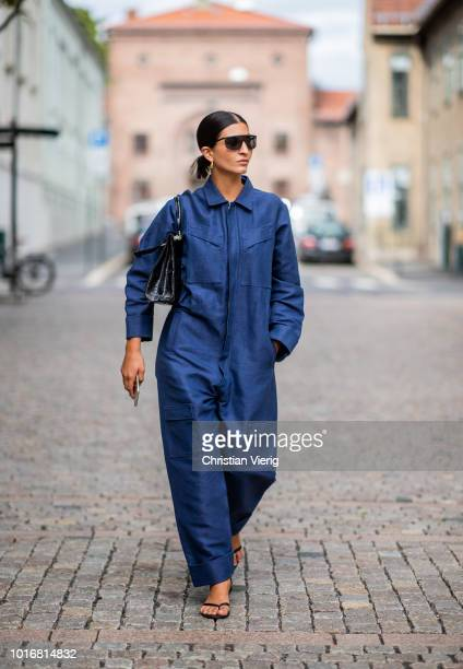 Katarina Petrovic wearing navy blue overall is seen outside Cathrine Hammel during Oslo Runway SS19 on August 14 2018 in Oslo Norway